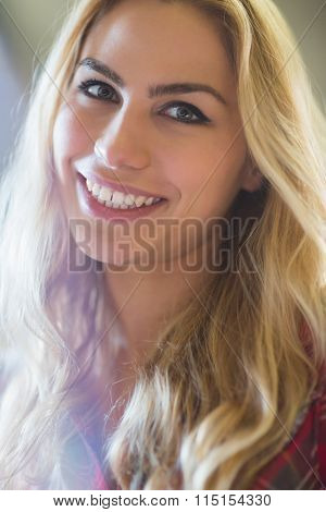 Smiling female student during class at the lecture hall