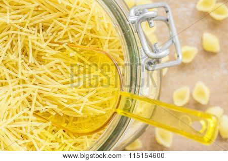 Pasta Vermicelli In A Container With A Shovel