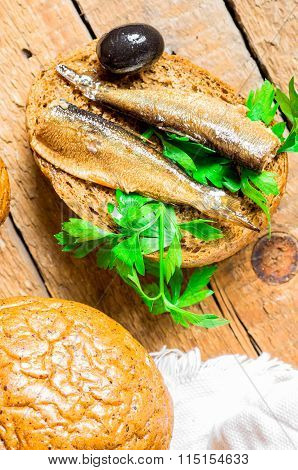 Bun With Sardines, Sprats And Olive