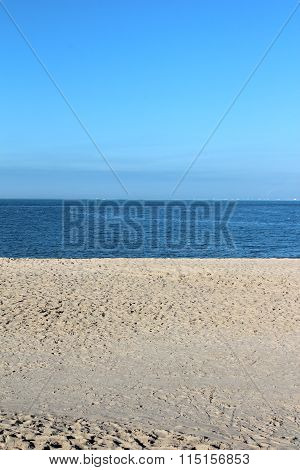 Blue Sky And Sand At The Arabian Gulf Seashore Vertical Shot