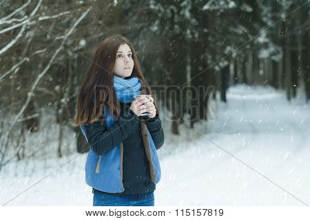 Forest Winter Portrait Of Daydreaming Young Lady Holding Cup With Hot Drink During Snowstorm In Fir