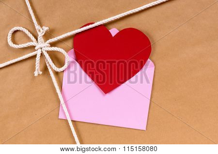 Valentines Day Gift With Heart Shape Card Or Gift Tag, Brown Paper Package Parcel Background