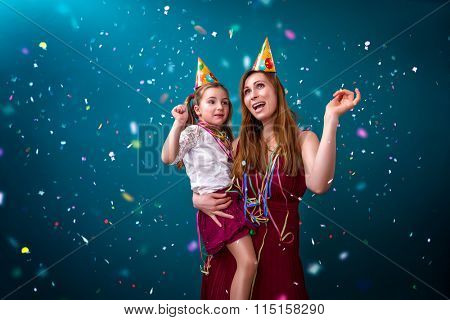 woman with daughter dancing in confetti rain