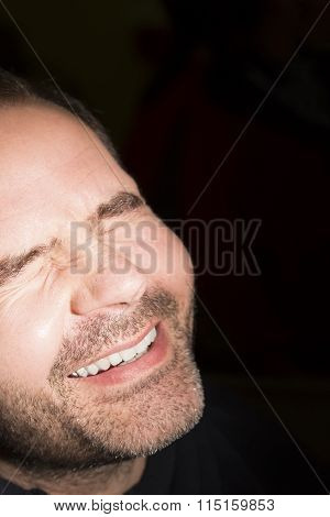 Close-up of business man smiling to the brightness