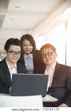 Asian Business Team In A Meeting