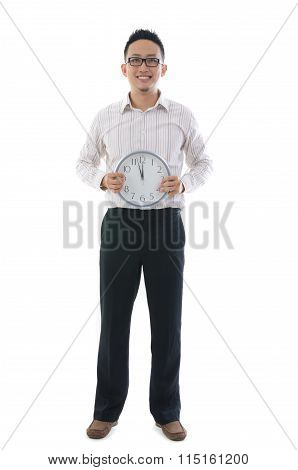 Asian Business Man Holding A Clock Concept Photo