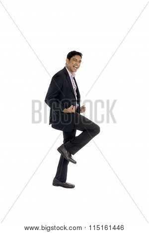 Indian Business Male Jumping In Joy`