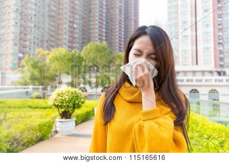 Asian Young woman runny nose