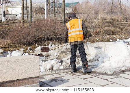 A Man Removes Snow With A Shovel. Volgograd, Russia