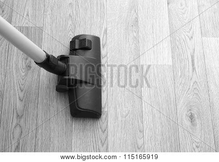 Vacuum Cleaner On Wooden Floor