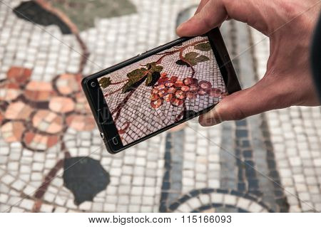 Man Taking photo Of Mosaic Floor Of Galeria Umberto I, Naples Italy
