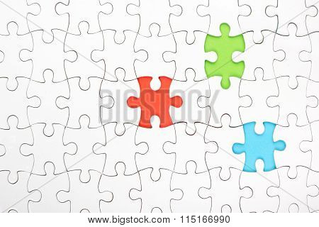 Missing jigsaw puzzle pieces. Colorful background. Copy space for text