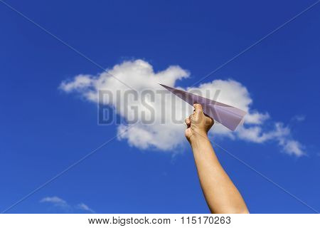 Holding Paper Airplane Before Throwing With Blue Sky Background.