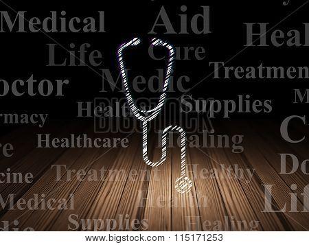 Medicine concept: Stethoscope in grunge dark room