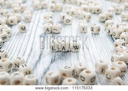 Law word written on wood block. Wooden ABC