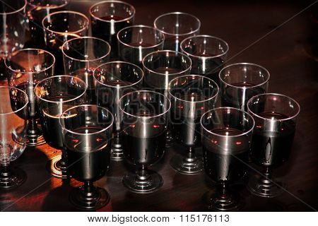 Red Wine In Glasses On Holiday Reception Table At Nightclub.
