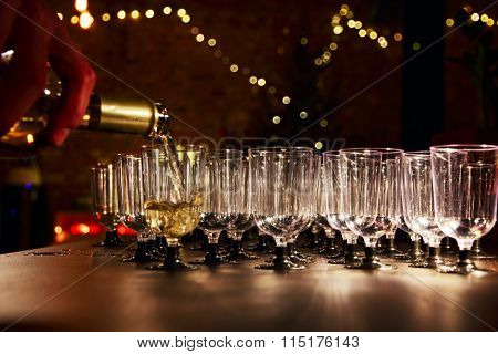 Waiter Pour White Wine In The Glass On Holiday Reception Table.