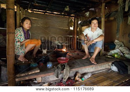 Asian young people are cooking in there primitive kitchen