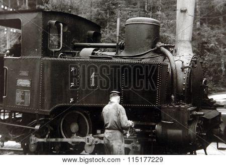 Antique Photo Mechanic Repairs Locomotive