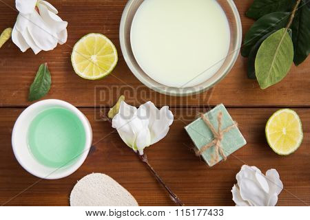 close up of body lotion, cream and soap on wood
