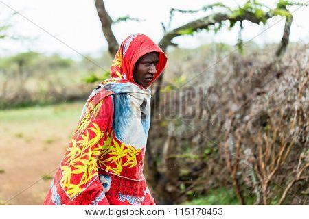 Massai man standing in the rain