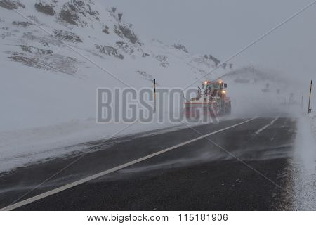Machine snowplow in mountain road in the Swiss alps