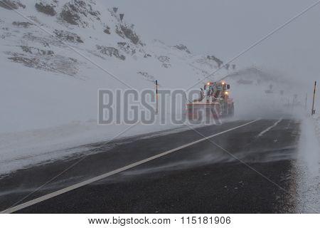 Machine snowplow in mountain road in the Swiss alps