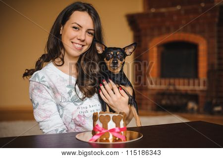 Woman Holds Toy Terrier With Dog Cake Infront On Birthday Party