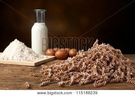 Uncooked Spiral Pasta With Manufacturing Materials