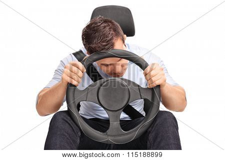 Studio shot of a young driver sleeping while driving isolated on white background