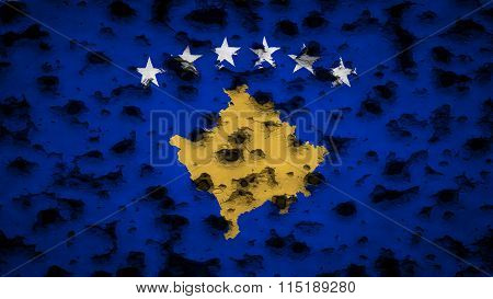 Flag of Kosovo painted on wall with bullet holes