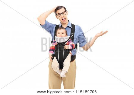 Studio shot of a young confused father carrying his daughter and gesturing with his hand isolated on white background