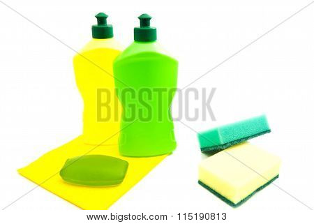 Sponges, Soap, Rag And Two Bottles