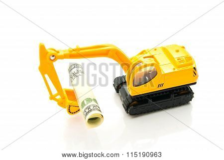 Dollars Banknotes And Backhoe