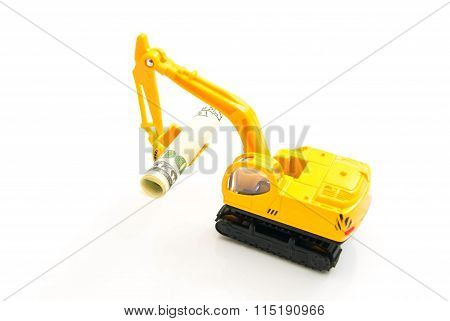 Dollars Banknotes And Yellow Backhoe