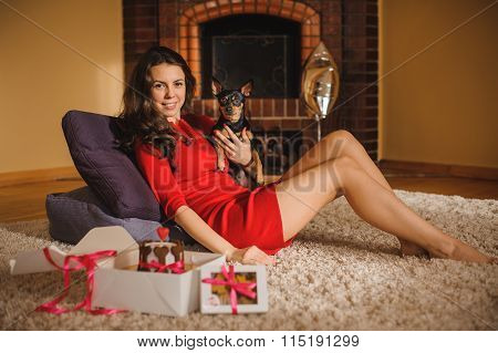 Woman And Toy Terrier With Dog Cake , Cookies Lying On Floor