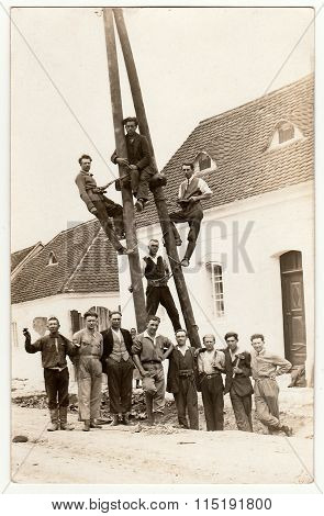 Vintage photo of electricians. Building of power lines circa 1930.