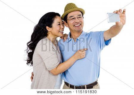 Man and woman taking a picture on a smartphone