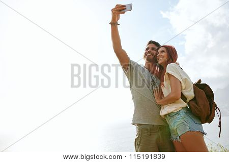 Loving Young Couple On Summer Vacation Taking A Selfie