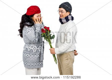Older asian man giving his wife flowers on white background
