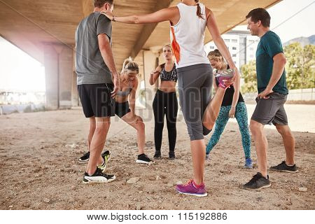 Running Club Group Stretching After Morning Run