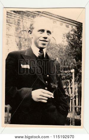 The vintage photo of man with cigarette. Portrait photo June 1941.