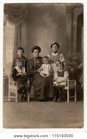 PRAGUE, THE CZECHOSLOVAK REPUBLIC - CIRCA 1930: The studio vintage photo shows family, circa 1930.
