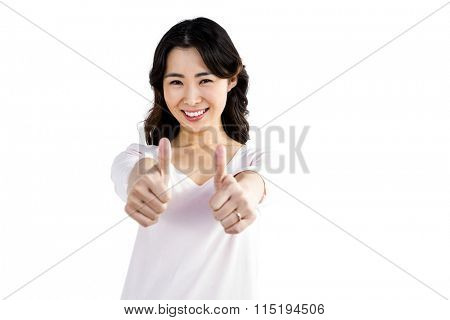 Beautiful woman showing thumps up against white background