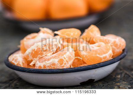 Ripe Juicy Mandarin Fruits In Enamel Plates On Blue Background