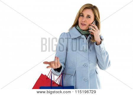 Woman being focused on her phone call during her shopping
