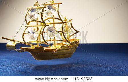 Ship Hovering Over Blue Velvet Surface