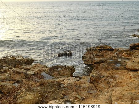 reefs and rocks in the sea outside during the day