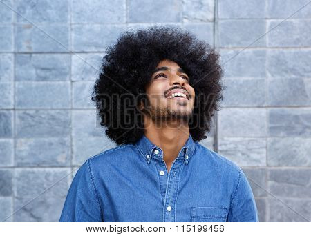 Young Black Guy Laughing And Looking Up