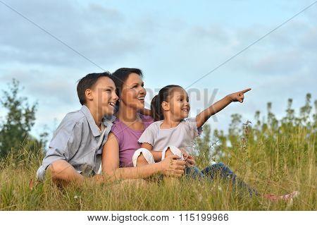 happy family at green field